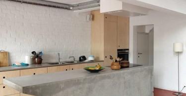 Кухонная рабочая зона с бетонным столом