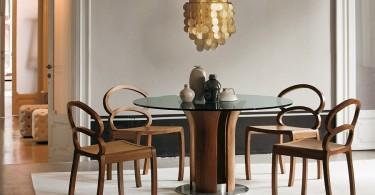 Стильный обеденный стол на скульптурном основании