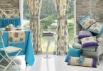 Шторы и подушки в интерьере стильной кухни