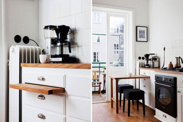 Деревянный выдвижной стол на кухне