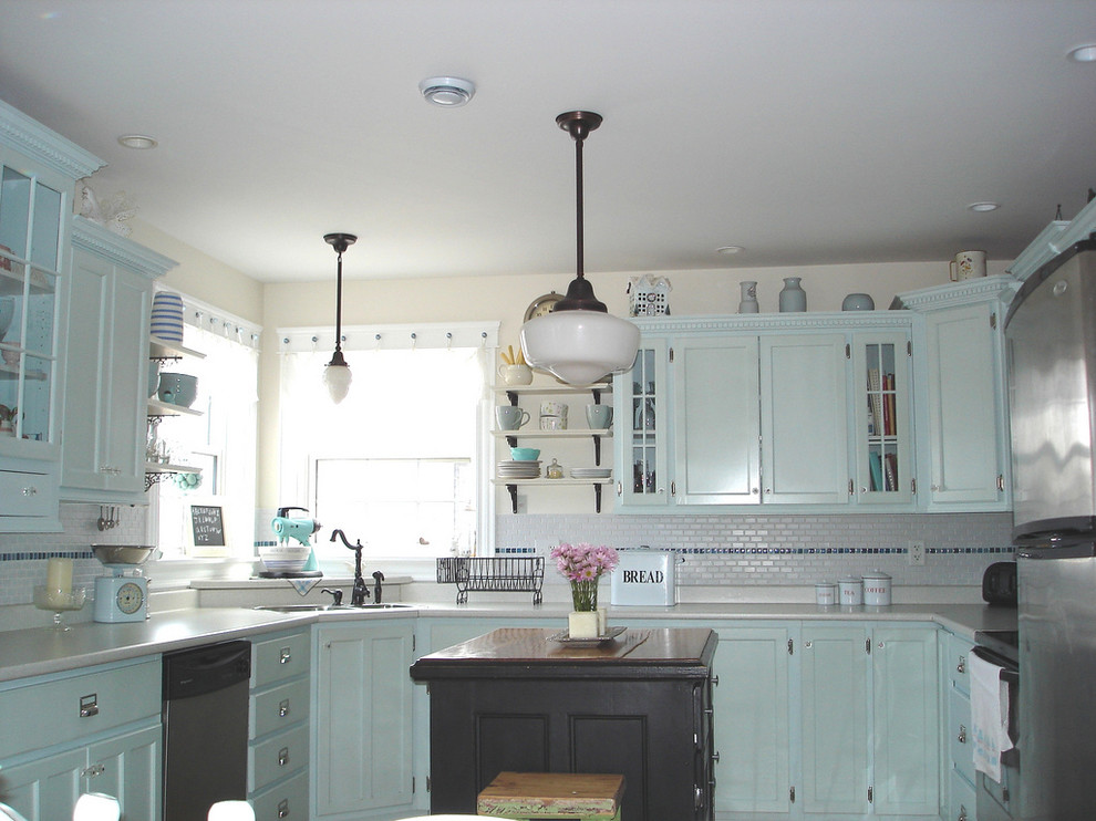 Ретро-дизайн интерьера кухни в голубых оттенках от Niki Papadopoulos