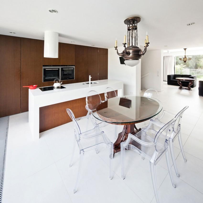 Роскошный деревянный стол на кухне - Фото 32