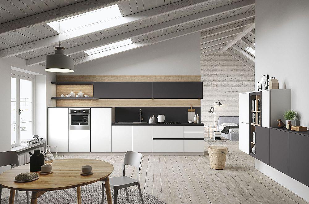 Круглый деревянный стол в дизайне кухни в светлых тонах