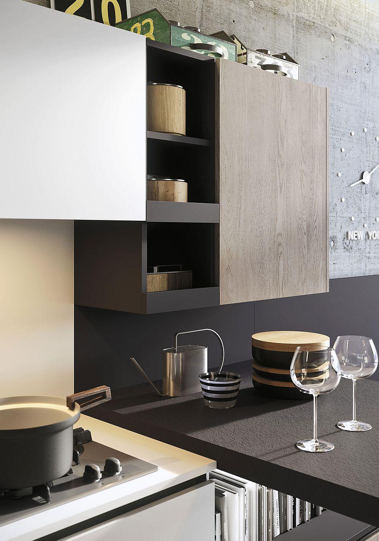 Чёрная матовая столешница в дизайне кухни в светлых тонах