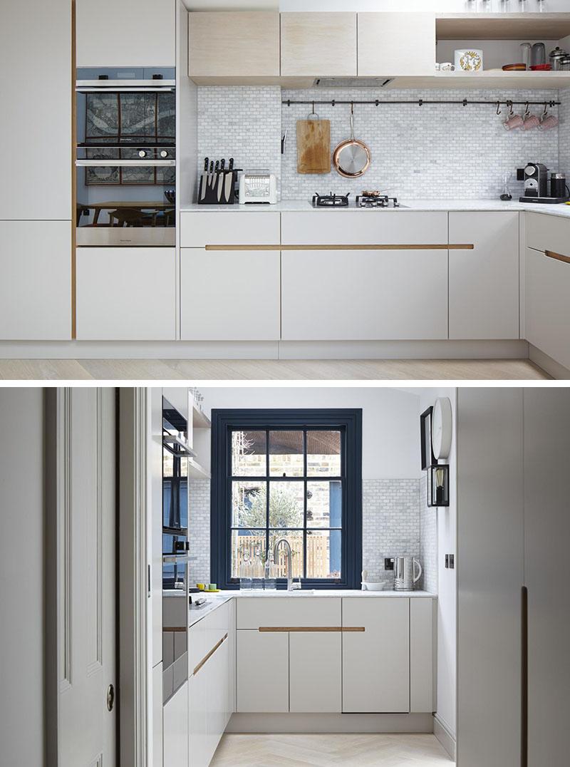дизайн кухонного гарнитура шкафы с интегрированными ручками