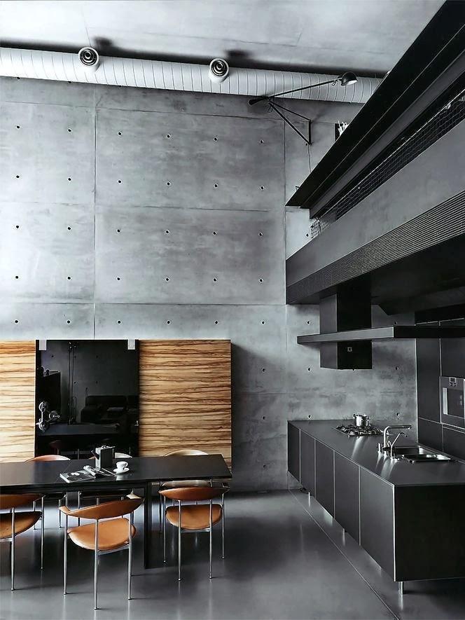 Серые бетонные стены в дизайне мужской кухни