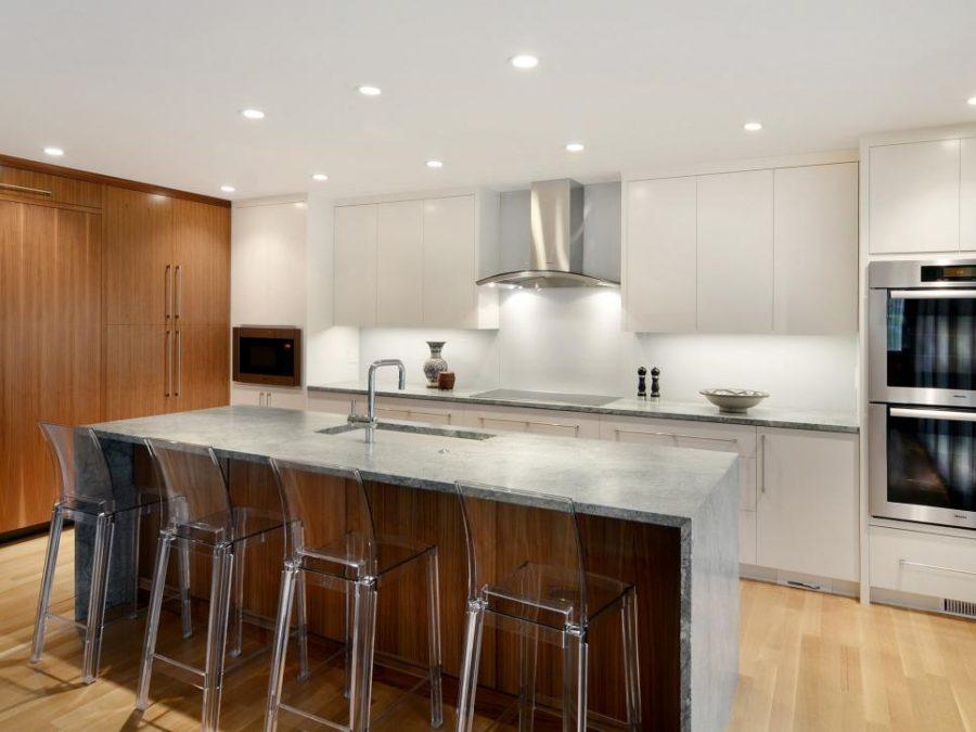 Элегантный дизайн кухонной столешницы для острова - вариант из бетона