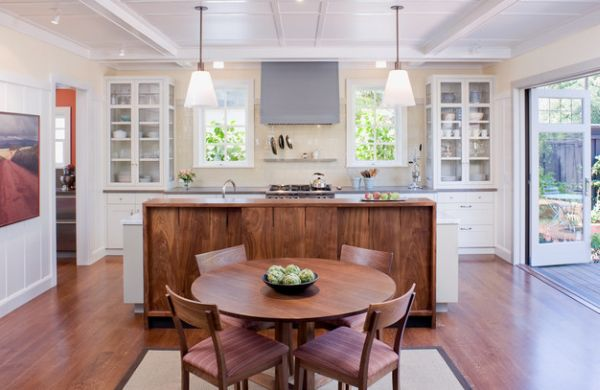 Круглый обеденный стол у кухонного острова
