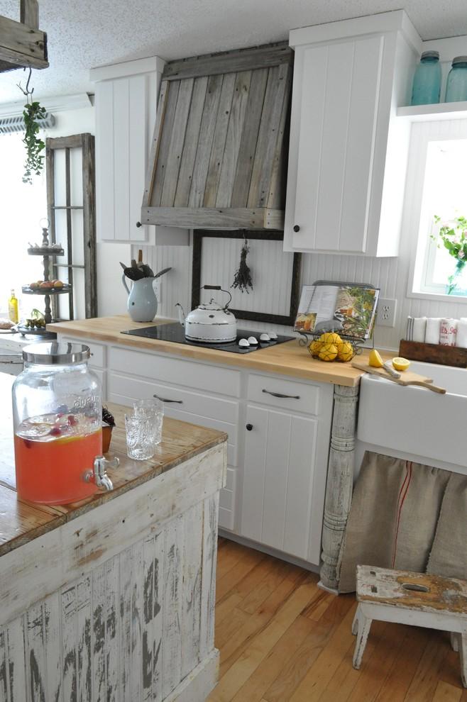 Оригинальный дизайн кухонной вытяжки в интерьере кухни - Фото 4
