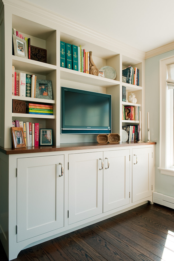 Шкаф с полками для книг, местом для телевизара и ящиками в нижней части