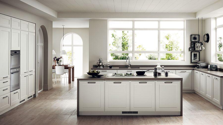 Белый кухонный остров с тёмной столешницей в интерьере кухни