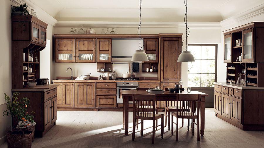 Деревянный угловой гарнитур в интерьере кухни